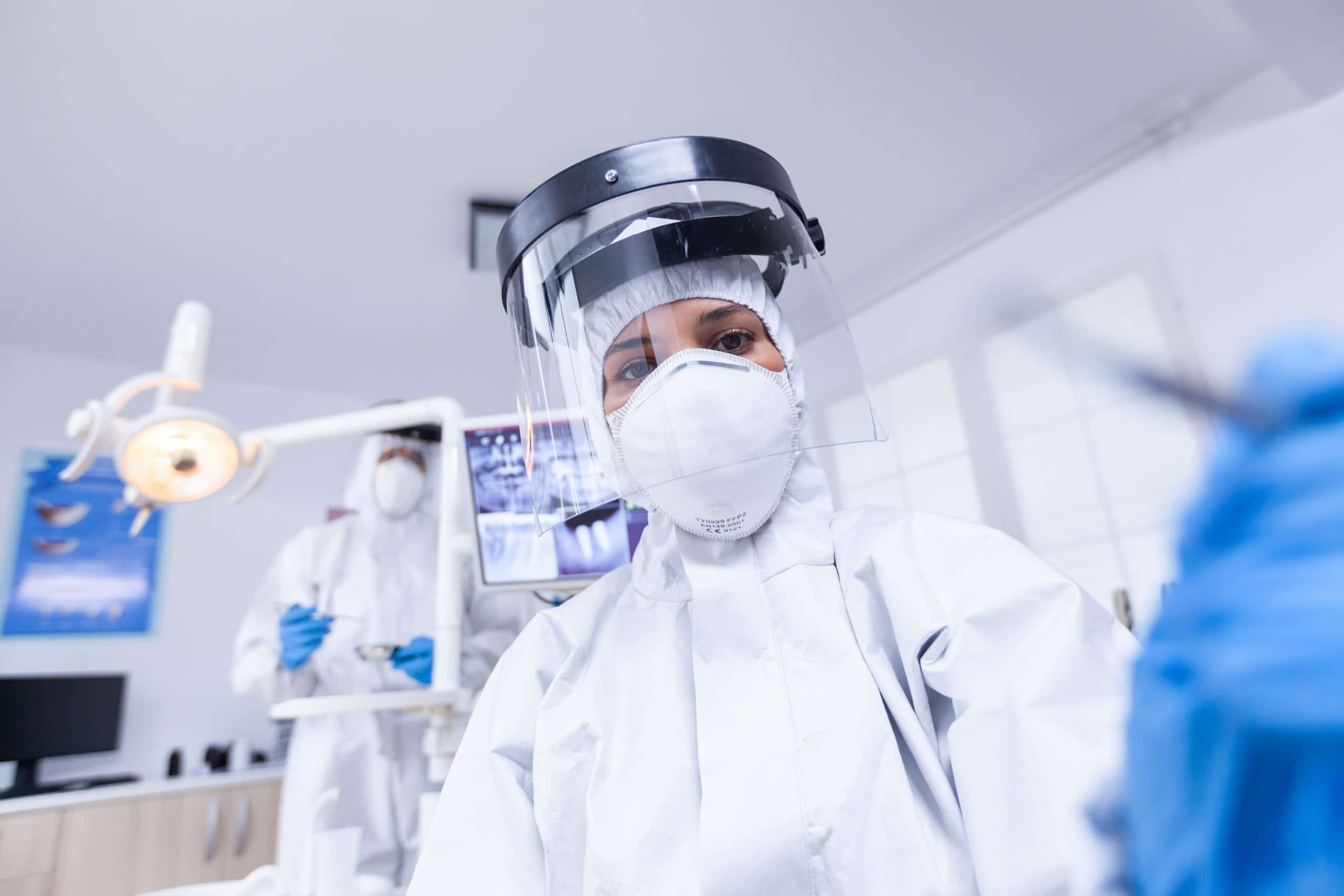 COVID UPDATE: Patient pov of Barnetby Medical Staff holding dental tools wearing covid protection