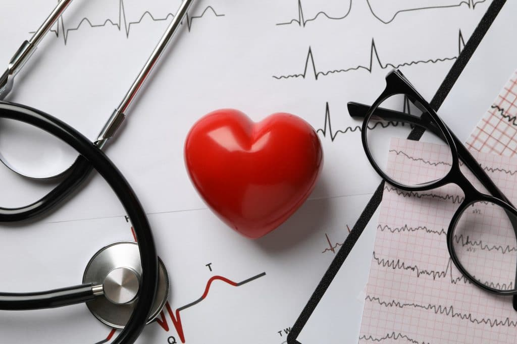 Medical concept with heart and electrocardiogram results, close up